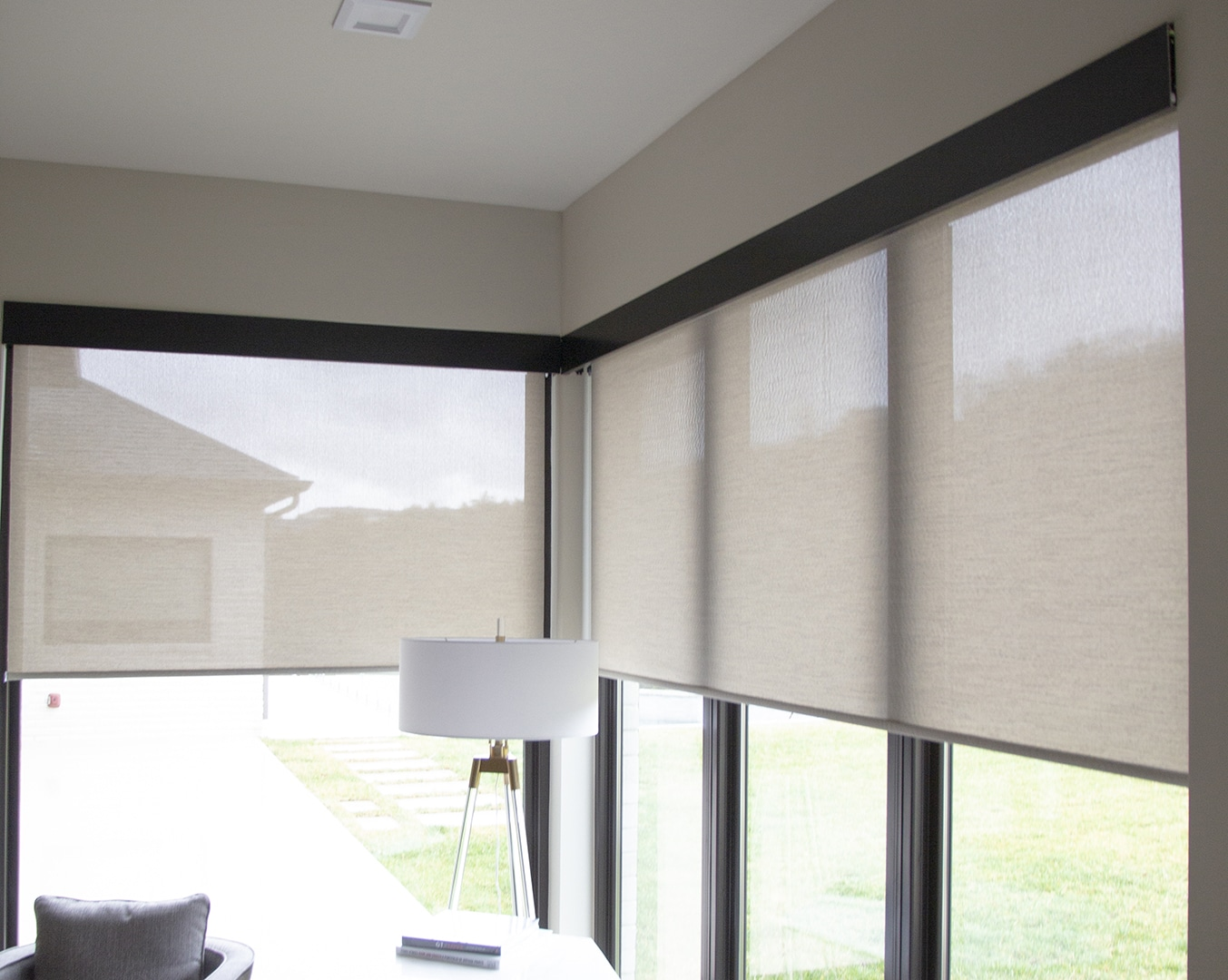 modern indoor space with interior roller shades half down