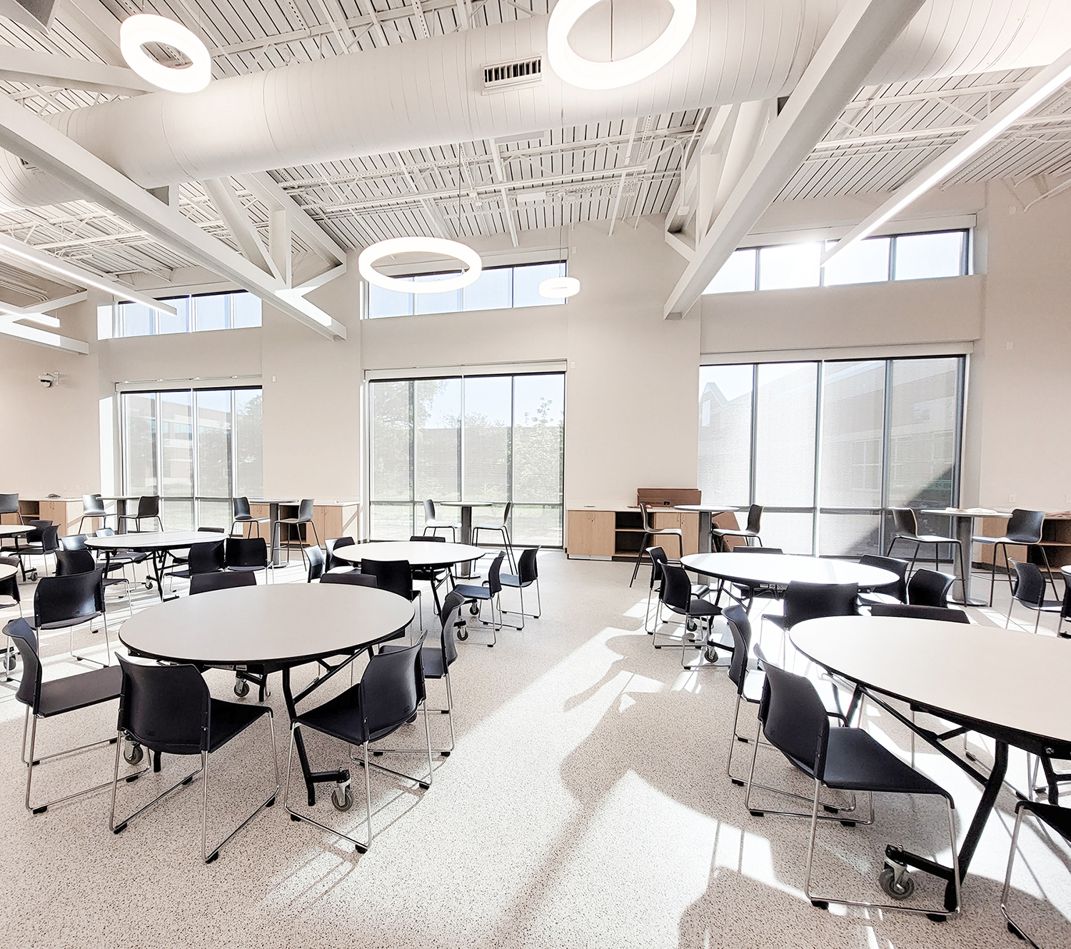 School cafeteria with roller shades